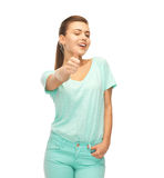 Smiling girl in color t-shirt showing thumbs up Stock Photos