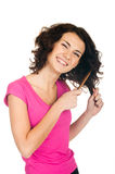 Smiling girl with comb Royalty Free Stock Photo