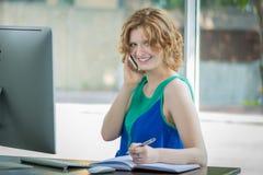 Smiling girl at computer Royalty Free Stock Photography