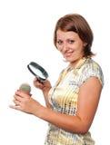 Smiling girl considers a cactus. Through a magnifier stock photos