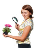Smiling girl considers cyclamens Royalty Free Stock Photo