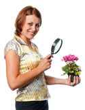 Smiling girl considers cyclamens Royalty Free Stock Image
