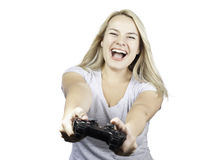 Smiling girl with controller playing video games. Girl holding a controller and playing video games. Happy, smiling and laughing yound woman isolated on whited Royalty Free Stock Images