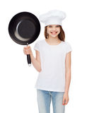 Smiling girl in cook hat with frying pan Royalty Free Stock Image