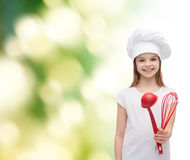 Smiling girl in cook hat with ladle and whisk Royalty Free Stock Photos