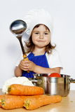 Smiling Girl in Cook's Cap Preparing Food Stock Image