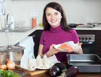 Smiling girl cooking fish pie with  salmon Stock Photography
