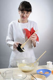 Smiling girl cooking sweets Stock Photo