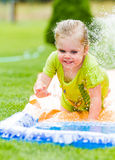 Smiling girl cooling off on a hot summer day Royalty Free Stock Photo