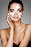 Smiling girl with cotton facial mask. royalty free stock photo