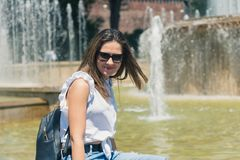 Smiling girl in the courtyard of Sforza Castle in Milan, Italy. Smiling girl in the courtyard of Sforza Castle in Milan, Italy royalty free stock images