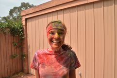 Smiling girl covered in powdered paint Stock Images