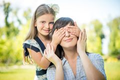 Smiling girl covering her mother eyes Royalty Free Stock Images