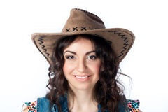 Smiling girl in cowboy hat Stock Photos