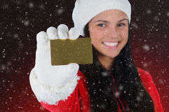 Smiling Girl with Credit Card and Snow Effect Stock Images