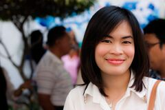 Smiling girl in the crowded Royalty Free Stock Photography
