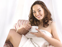 Smiling girl with cup of tea Royalty Free Stock Photos