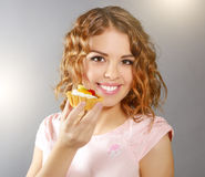 Smiling girl with cupcake Stock Images