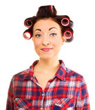 Smiling girl with curlers Stock Photos