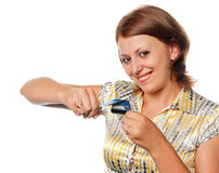 Smiling girl cuts a credit card Stock Photo