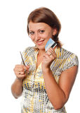 Smiling girl cuts a credit card Stock Images