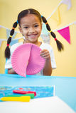 Smiling girl cutting a paper plate Royalty Free Stock Photo