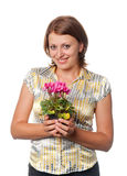 Smiling girl with cyclamens Royalty Free Stock Image