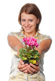 Smiling girl with cyclamens Royalty Free Stock Photo