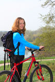Smiling girl cyclist Royalty Free Stock Images