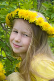 Smiling girl in dandelion wreath Royalty Free Stock Photos
