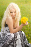Smiling girl with dandelions, head Royalty Free Stock Photo