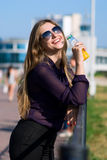 The smiling girl in dark glasses Stock Image