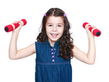 Smiling girl in a denim dress with dumbbells Stock Photos