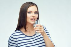 Smiling girl with dental braces drinking water. From glass. Isolated portrait Stock Photos