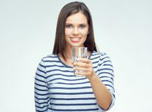 Smiling girl with dental braces drinking water. From glass. Isolated portrait Royalty Free Stock Image