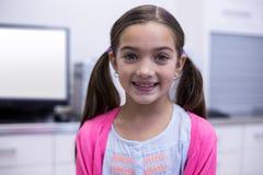 Smiling girl in dental clinic stock image