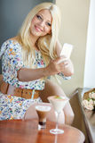 Smiling girl with dessert Stock Photography