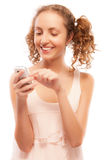 Smiling girl dials number on phone Stock Photo