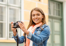 Smiling girl with digiral photocamera in the city Stock Photo