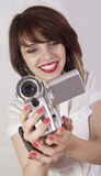 Smiling girl with digital camera Royalty Free Stock Image