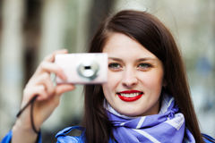Smiling girl with digital camera Royalty Free Stock Photo