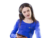 Smiling girl with digital tablet singing Royalty Free Stock Images