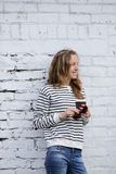Smiling girl with a disposable coffee cup Royalty Free Stock Image