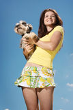Smiling girl and dog Royalty Free Stock Photography
