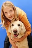 Smiling girl with dog. Happy blond teenager girl with her golden retriever dog Stock Images