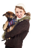 Smiling girl with dog in winter coat Royalty Free Stock Photography