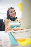 Smiling girl doing assignment in the computer room Royalty Free Stock Image