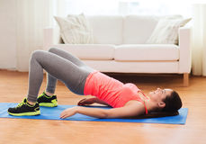 Smiling girl doing exercise for legs and buttocks Stock Photo