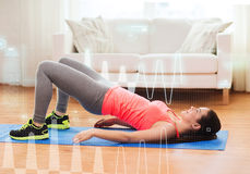 Smiling girl doing exercise for legs and buttocks Royalty Free Stock Photos