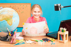 Smiling girl doing her homework Stock Images